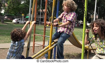 Brothers Playing on Swing Set