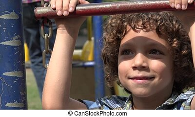 Boy Smiling on Playground