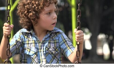 Boy Swinging on Swing Set