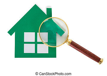 Closeup Of Magnifying Glass And Green Paper House - Closeup...