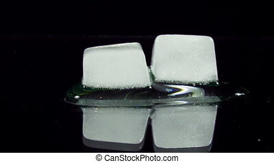 Ice Cube Melting and Moving on a Glass Surface - Many Ice...