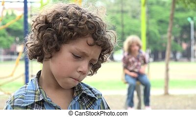 Sad Young Boy at Playground
