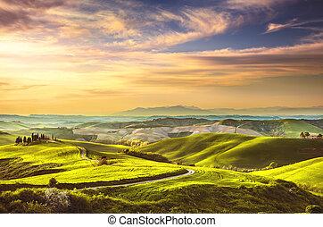 Tuscany spring, rolling hills on sunset. Rural landscape....