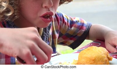 Young Boy Eating with Fork