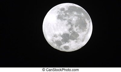 Super full moon light in clear night sky.