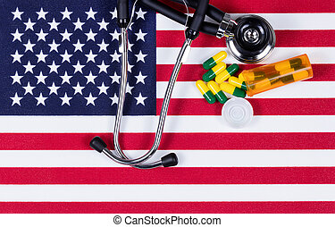 Medical concept with stethoscope and capsules on the United States flag