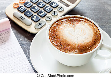 Coffee cup on work station, stock photo
