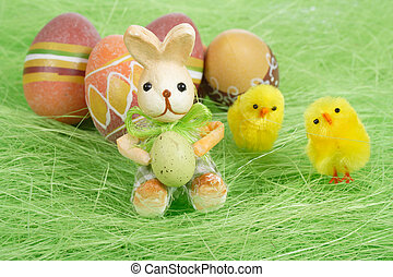 Easter bunny and chicks, Painted brownl Easter Eggs on green...