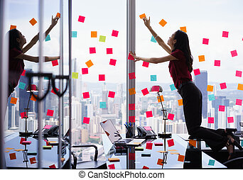 Busy Person Attaching Many Sticky Notes On Large Window -...