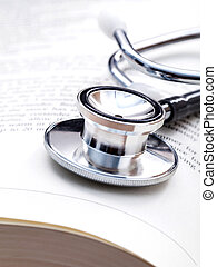 Stethoscope on a textbooks with shallow depth of field for...