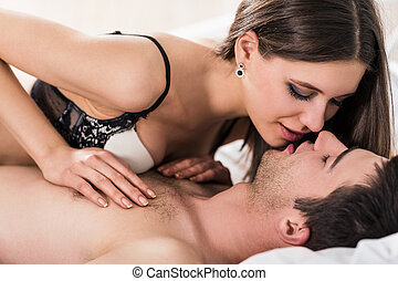 Young couple hugging and kissing - Young romantic couple...