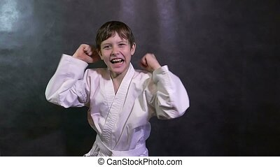 Karate boy screaming kid success teenager victory rejoices slow motion
