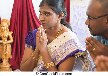 Indian people praying - People pray during praying events...