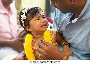 Traditional Indian Hindus ear piercing ceremony.