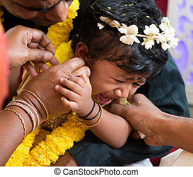 Traditional Indian family ear piercing ceremony