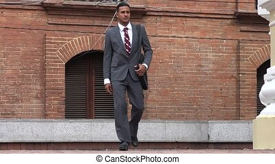 Business Man Walking to Camera