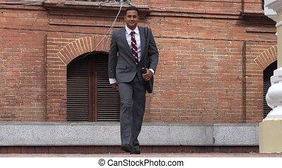 Business Man Walking to Camera