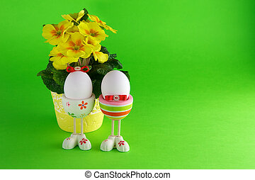 Easter eggs and primula on a green background