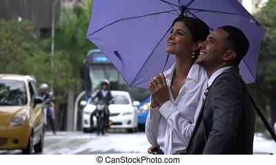 Man and Woman Happy in Rain