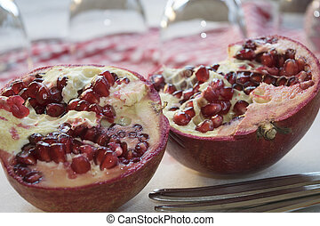 two half of a ripe pomegranate