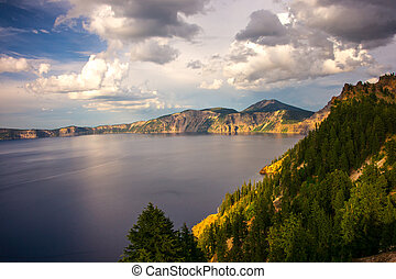 Crater Lake at Sunset - Late afternoon light illuminates the...