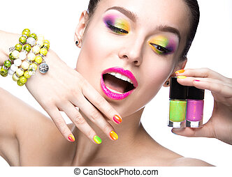 girl with bright colored makeup - Beautiful model girl with...