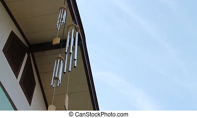 Oriental wind bells ringing with blue sky, stock video
