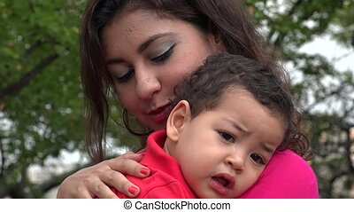 Tired Baby Boy With Mother