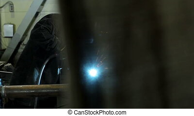 Welder at work in factory Welding - Welder at work in...