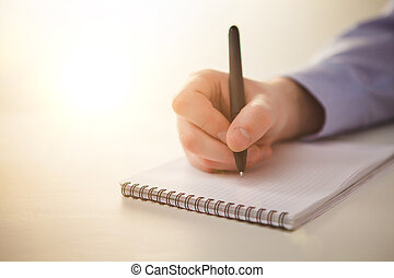 The male hand with a pen