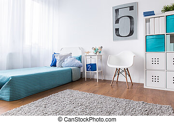 Child bedroom in light colors with bed and modern shelving...