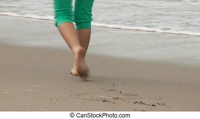 Woman walks At Beach