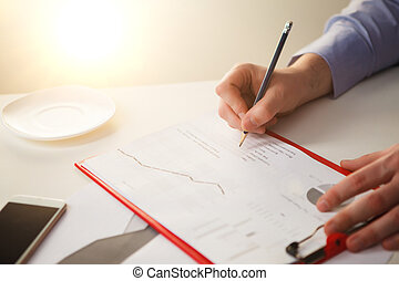 The male hand drawing a graph of growth
