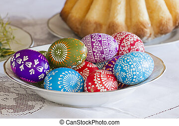 Traditional Easter celebratory table. Colored eggs and cake...