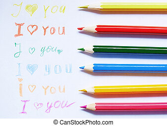Love you - Paper with love you message and colored pencils