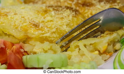 closeup shepherds pie with fork on plate - closeup shepherds...