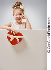 girl with red heart - Sweet child girl with white blank...
