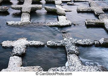 cross shaped rocks - Cross shaped rocks in a stream in Kyoto...