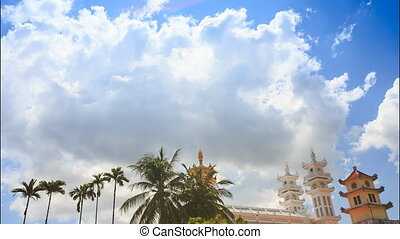 Clouds Motion over Palms Ancient Pagoda Roofs - clouds...