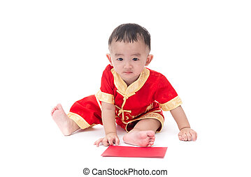 Cute Asian baby in traditional Chinese suit with red pocket,...