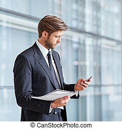 Keeping in touch with the stats - Corporate executive using...