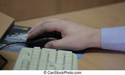 Male hand clicking computer mouse - hand clicking computer...