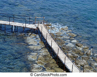 Footbridge - The footbridge and stones on the seashore