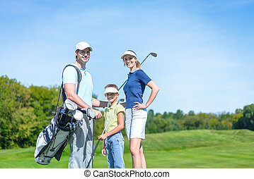 Vacations - Smiling family on the golf course