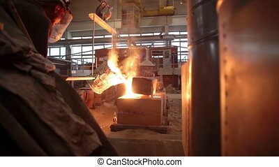 Molten metal in a steel mill in factory