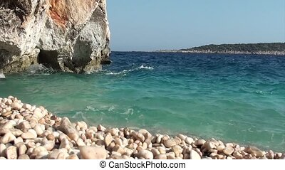 A man jumping into the sea from a rock