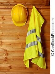 Hard hat - Safety helmet and safety jacket hanging up