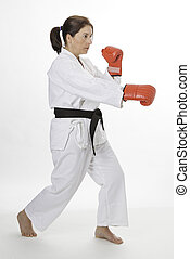 Lower punch - woman in her fortie, wearing red boxing glove...