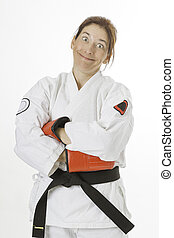 Funny face fighter - woman wearing a karate uniform and red...