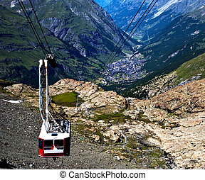 Cable car - A cable car in the swiss alps with a valley...